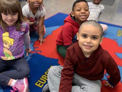 Photo: Students looking up at camera smiling