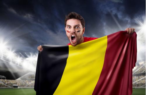 Belgian soccer fan holds Belgian flag