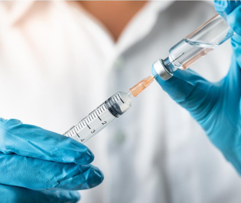 health worker prepares injection