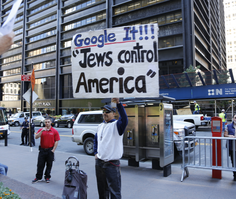 SEPTEMBER 17 2014 Occupy Wall Street protester with sign: Google It!!! Jews control America
