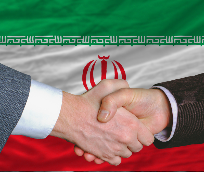 handshake against backdrop of Iranian flag symbolizes Iran Deal
