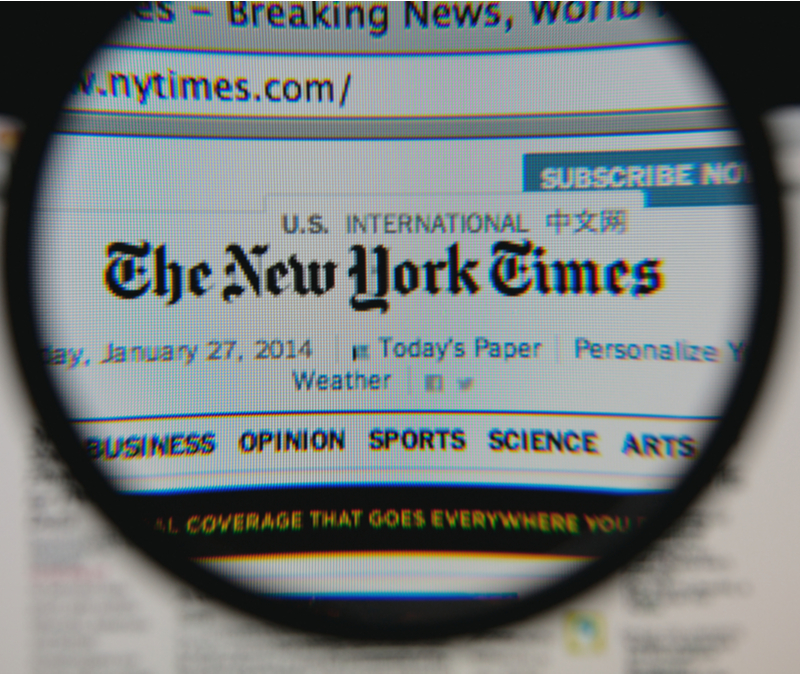 new york times through lens of magnifying glass suggesting scrutiny for media bias