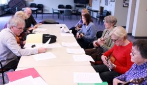 Read more about the article Strumming Hingham seniors love learning the ukulele