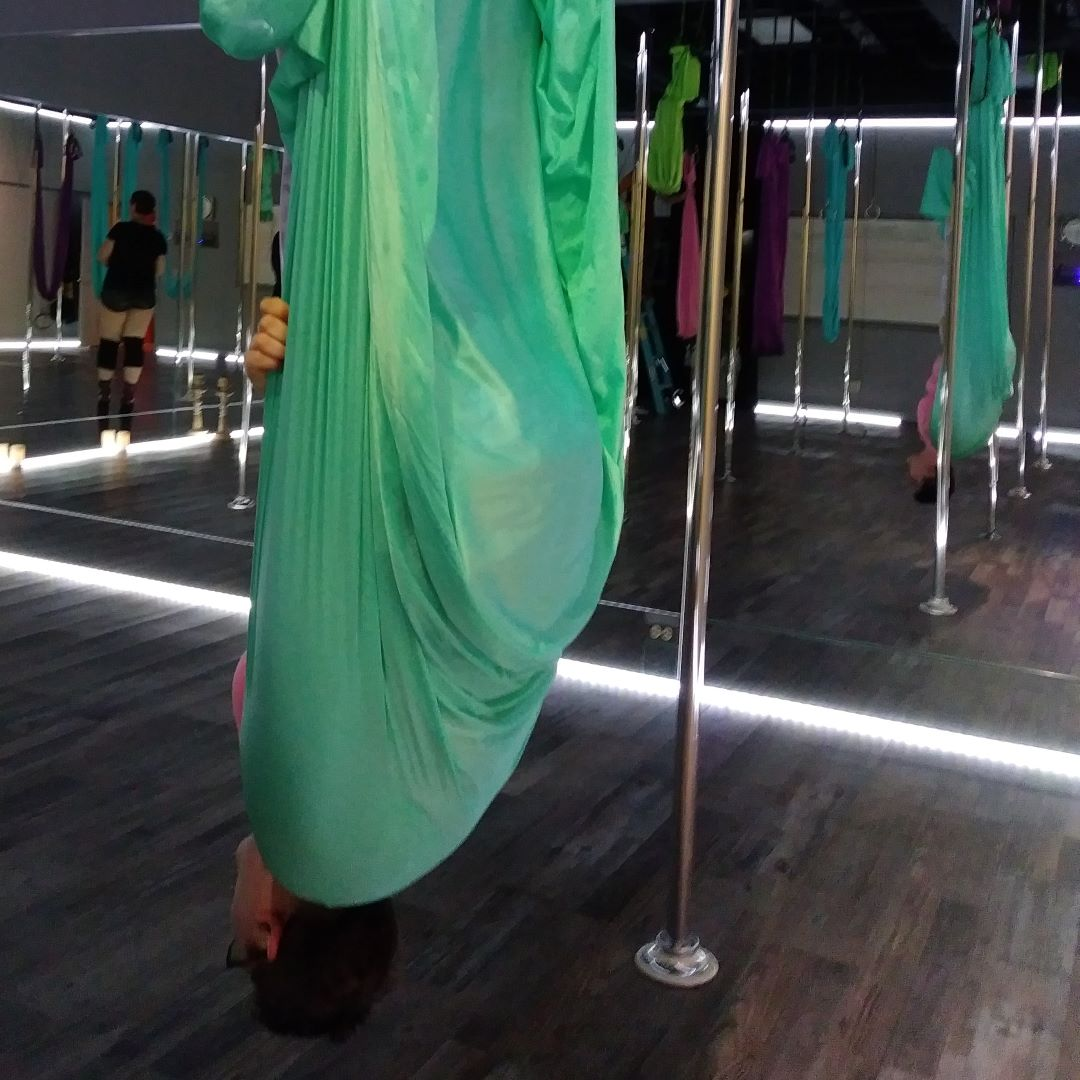 Leah Z does the Vampire (Shoulder Stand) in Aerial Yoga class