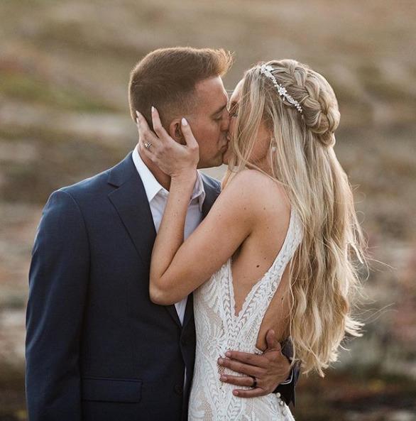 bride and groom romantic kiss on beach