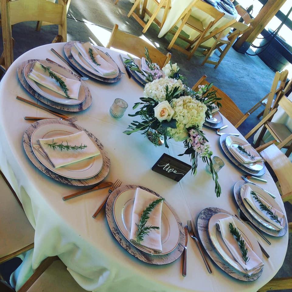 elegant place settings at barn wedding reception