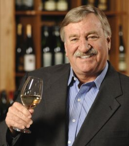 photo of jim trezise holding a glass of wine