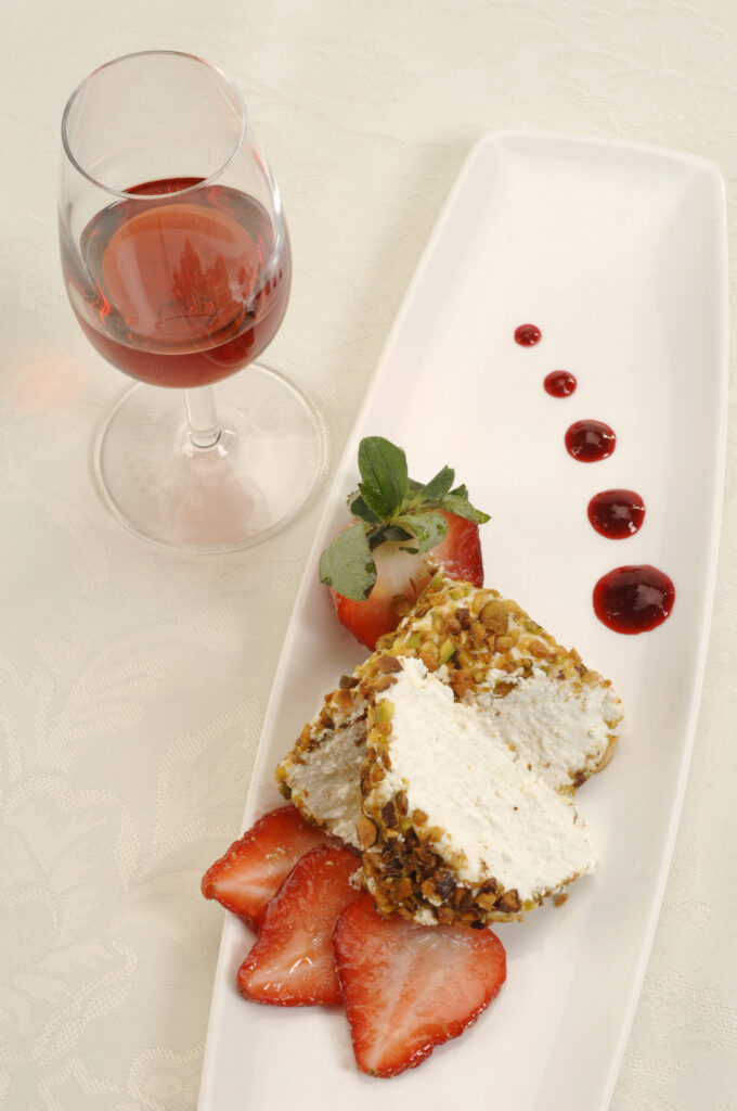 Farmer's Cheese with Strawberries on plate with glass of red wine