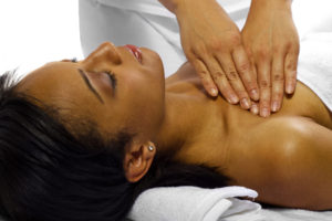 therapist/masseuse treating a young black female client