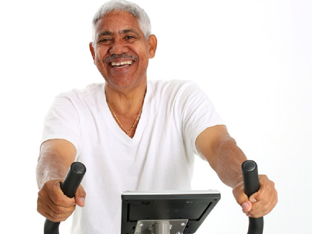 Older man on stationary bike, wondering about Social Security and Medicare benefits in the future