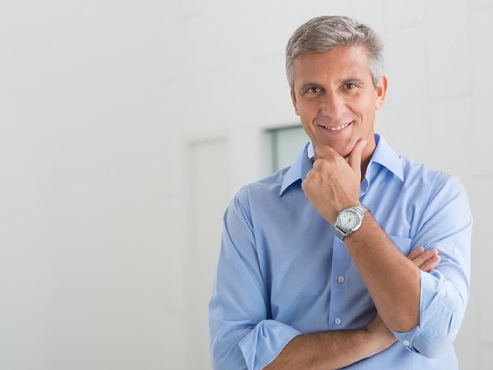 Middle-aged business man considers New Year resolutions for business and career success