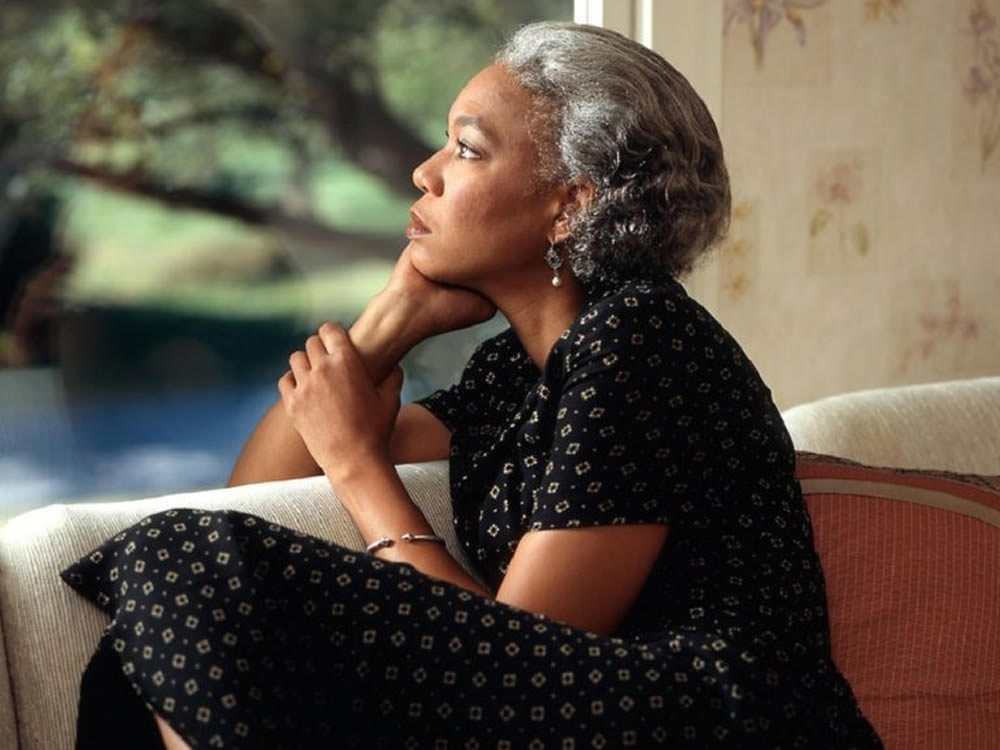 Pensive woman thinking about estate planning mistakes to avoid