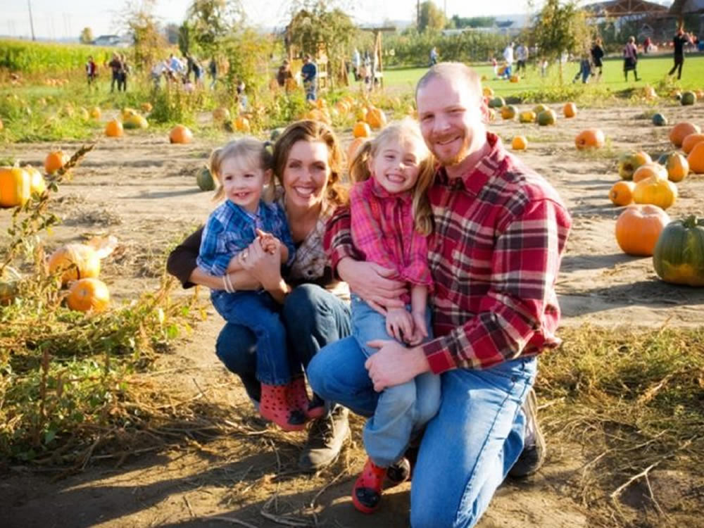 Young family in pumpkin patch are grateful for family gifting