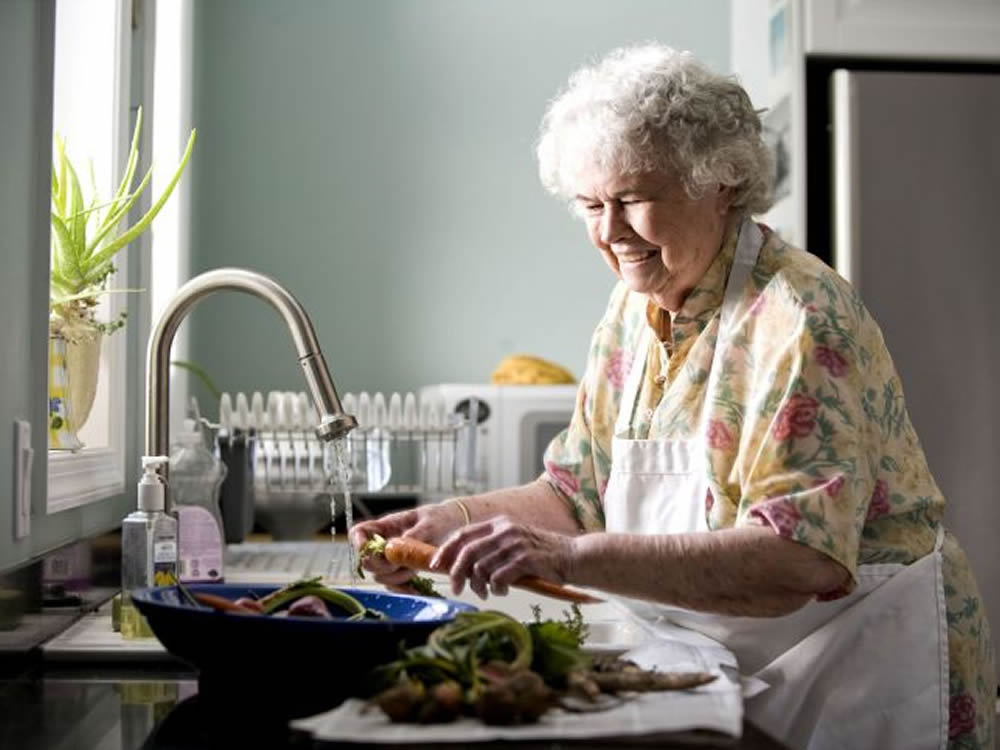 Old lady living independently thanks to sensible housing choices in retirement