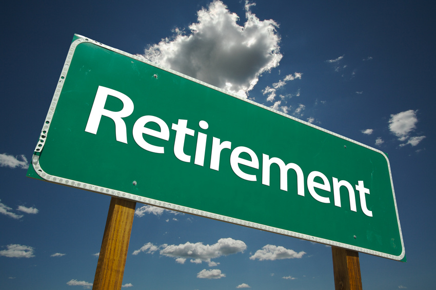 Green retirement road sign, directing you to saving enough for retirement