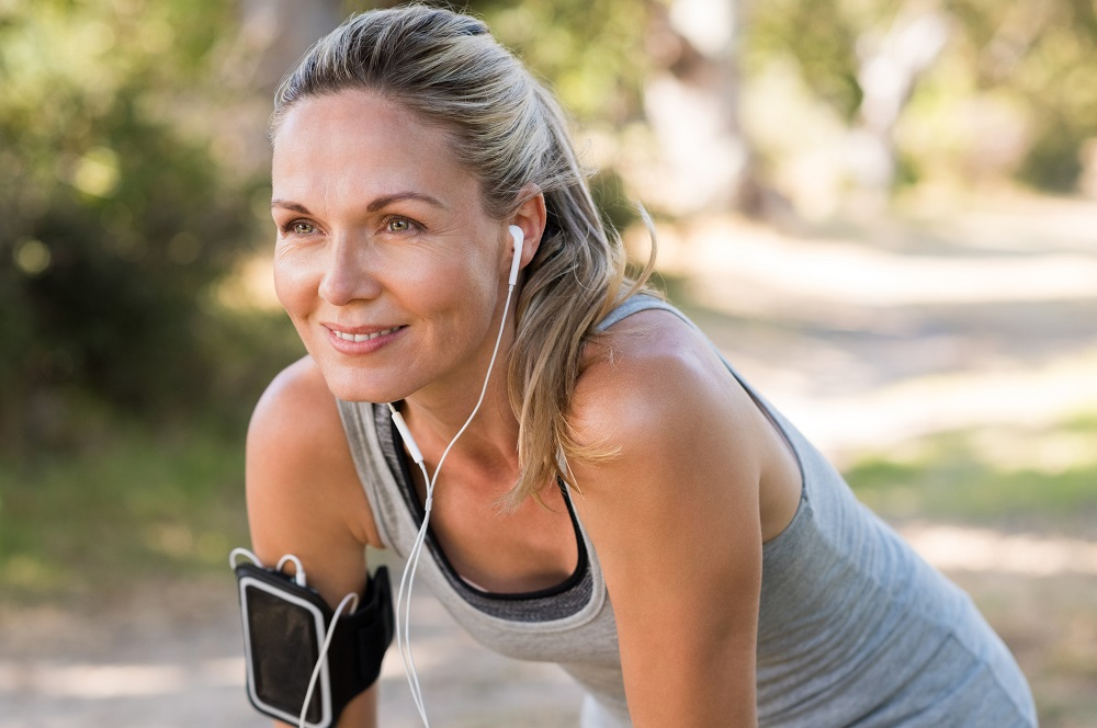 Woman jogger considering the future and the countdown to retirement