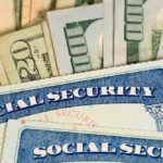 US Social Security cards and dollar bills to illustrate the importance of maximizing your retirement benefits