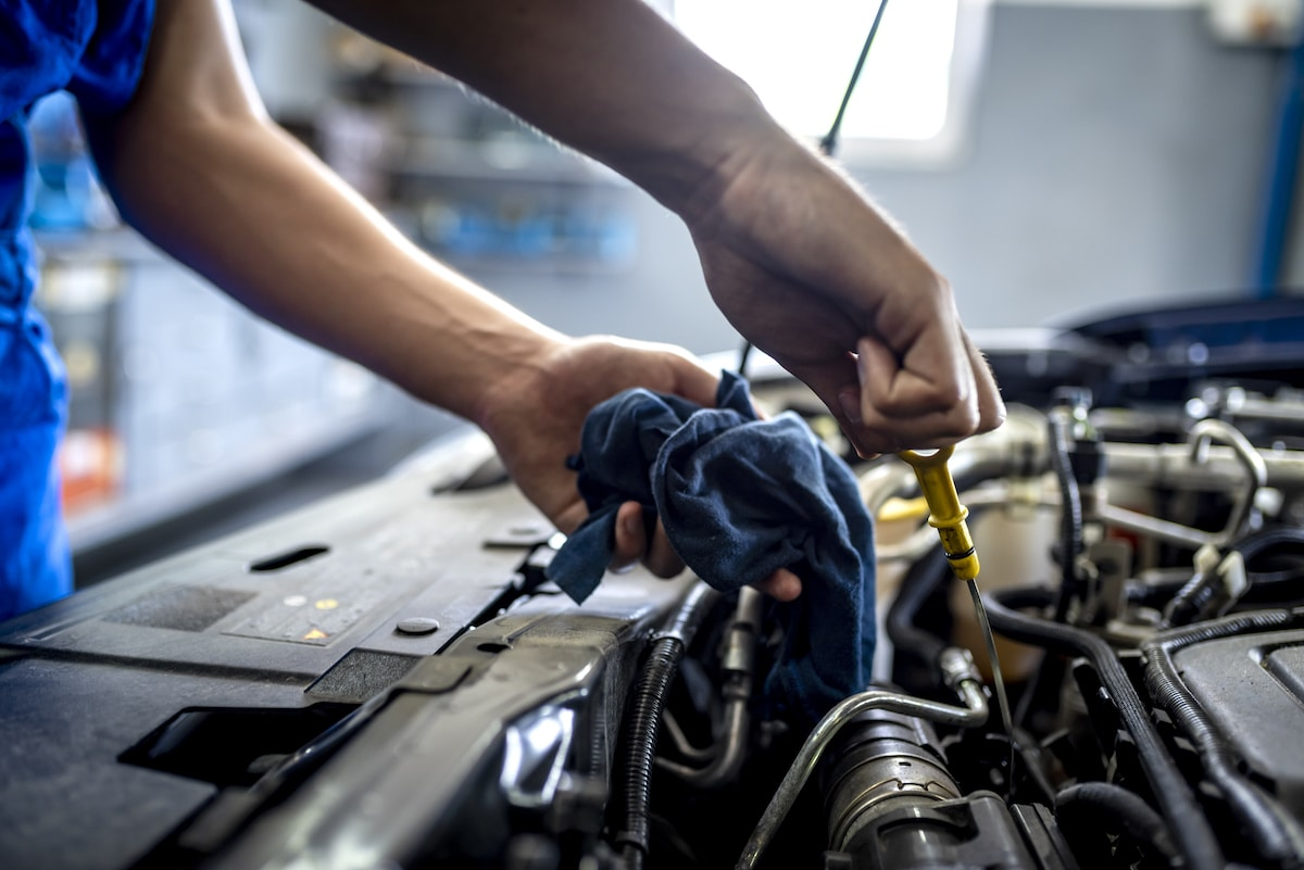 Checking oil in car engine