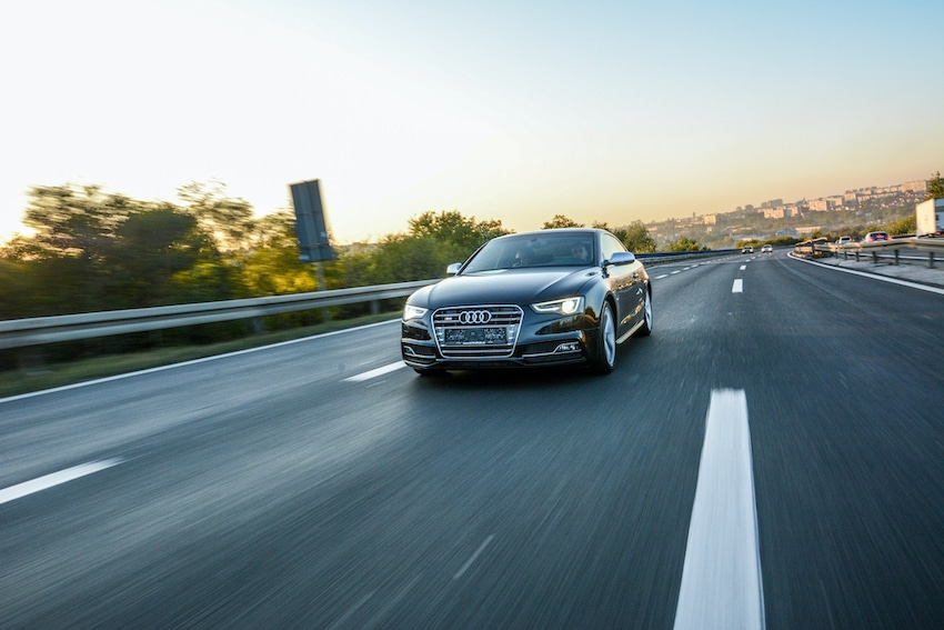 Audi driving down the road