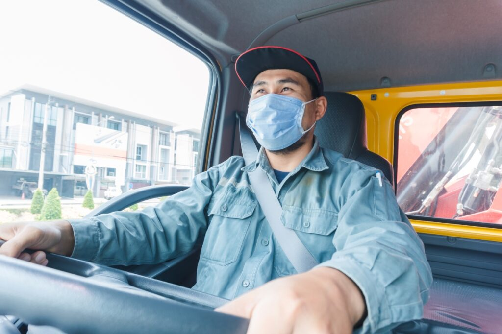 Truck driving wearing mask
