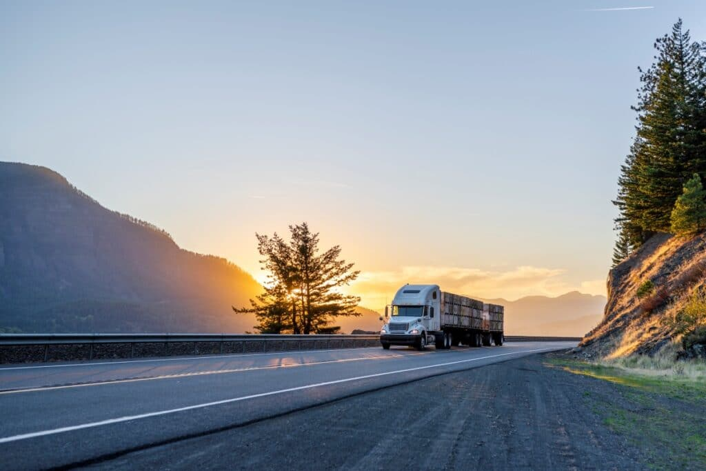 Truck driving at sunrise