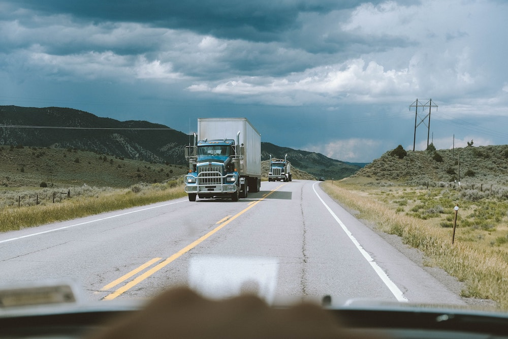 Truck driving down two lane highway