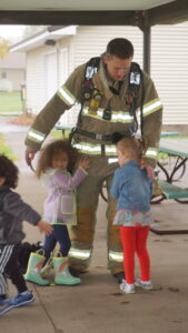 Messiah Lutheran, preschool, young children, field trip, three-year-olds, firemen visit, learning, hugging