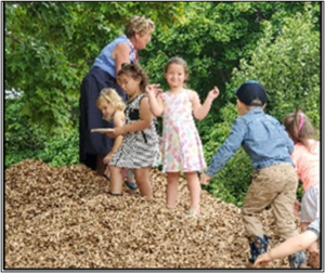 Messiah Lutheran, preschool, young children, playground, wood chip pile, learning