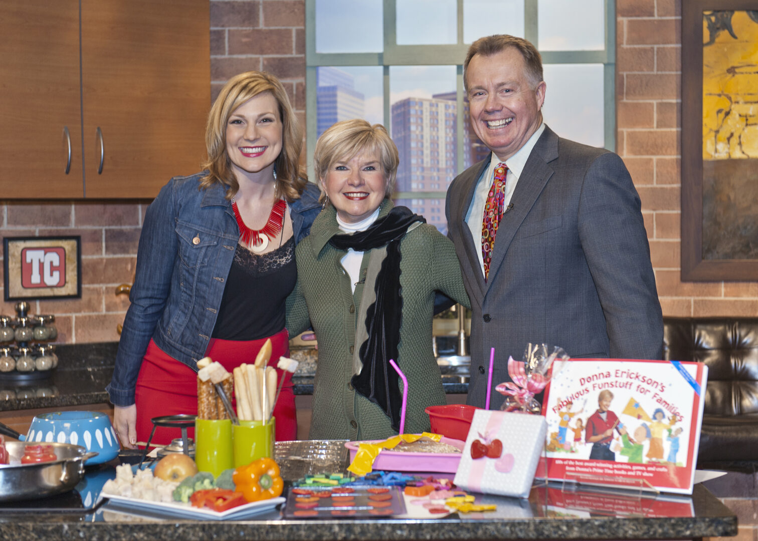 "Donna on the set of ""Twin Cities Live"" with host Elizabeth Reis and meteorologist Dave Dahl."
