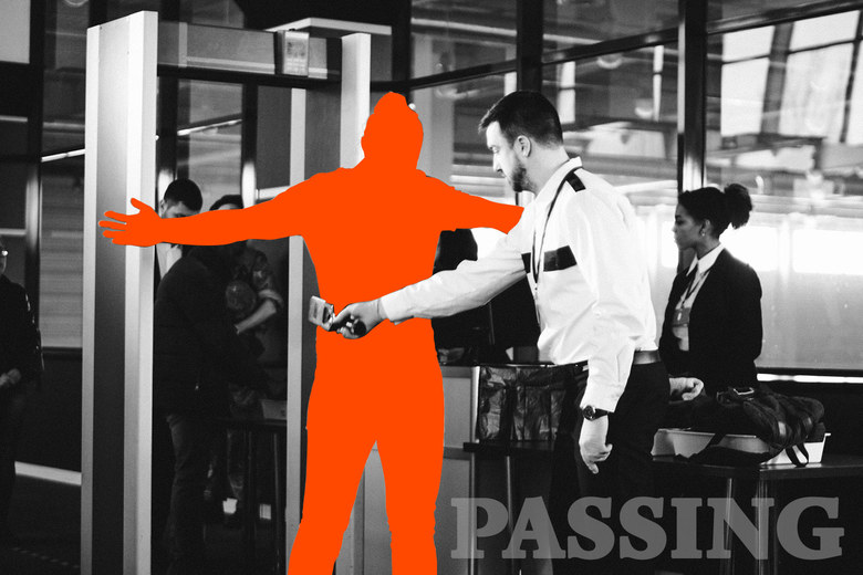 A silhouetted person going through airport security.