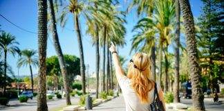 Tucson Ranks Best Places for Gays and Lesbians to Live, girl in palm tree-lined street