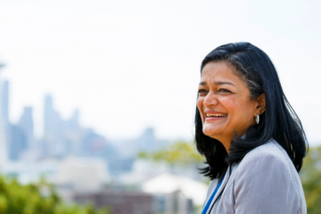 Congresswoman Pramila Jayapal in front of the Seattle skyline