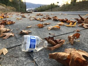 Discarded plastic water bottle on the sidewalk