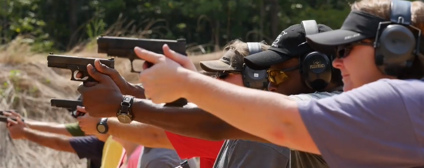 Gunowners training with their pistols