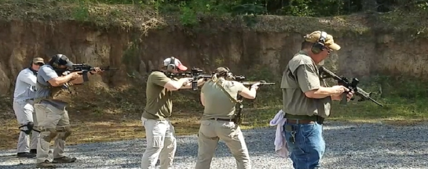 Men learning how to use rifles