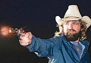 A man firing his pistol