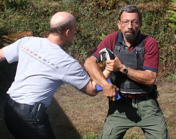 A training on disarming a gun user