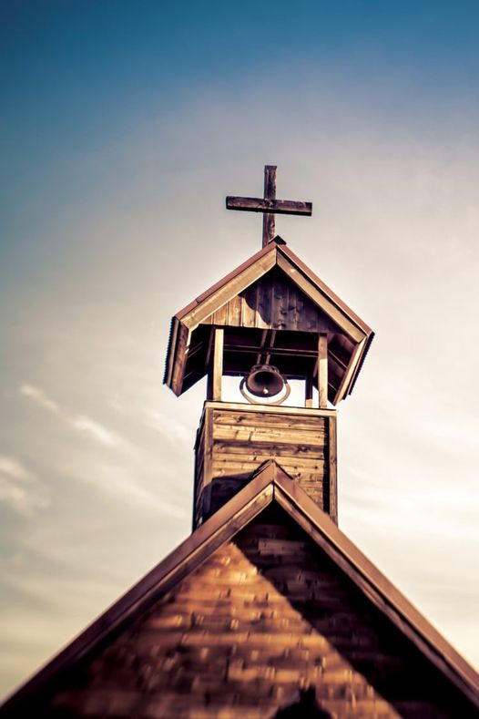 A church bell and a cross