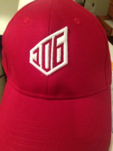 Red baseball cap with custom embroidery