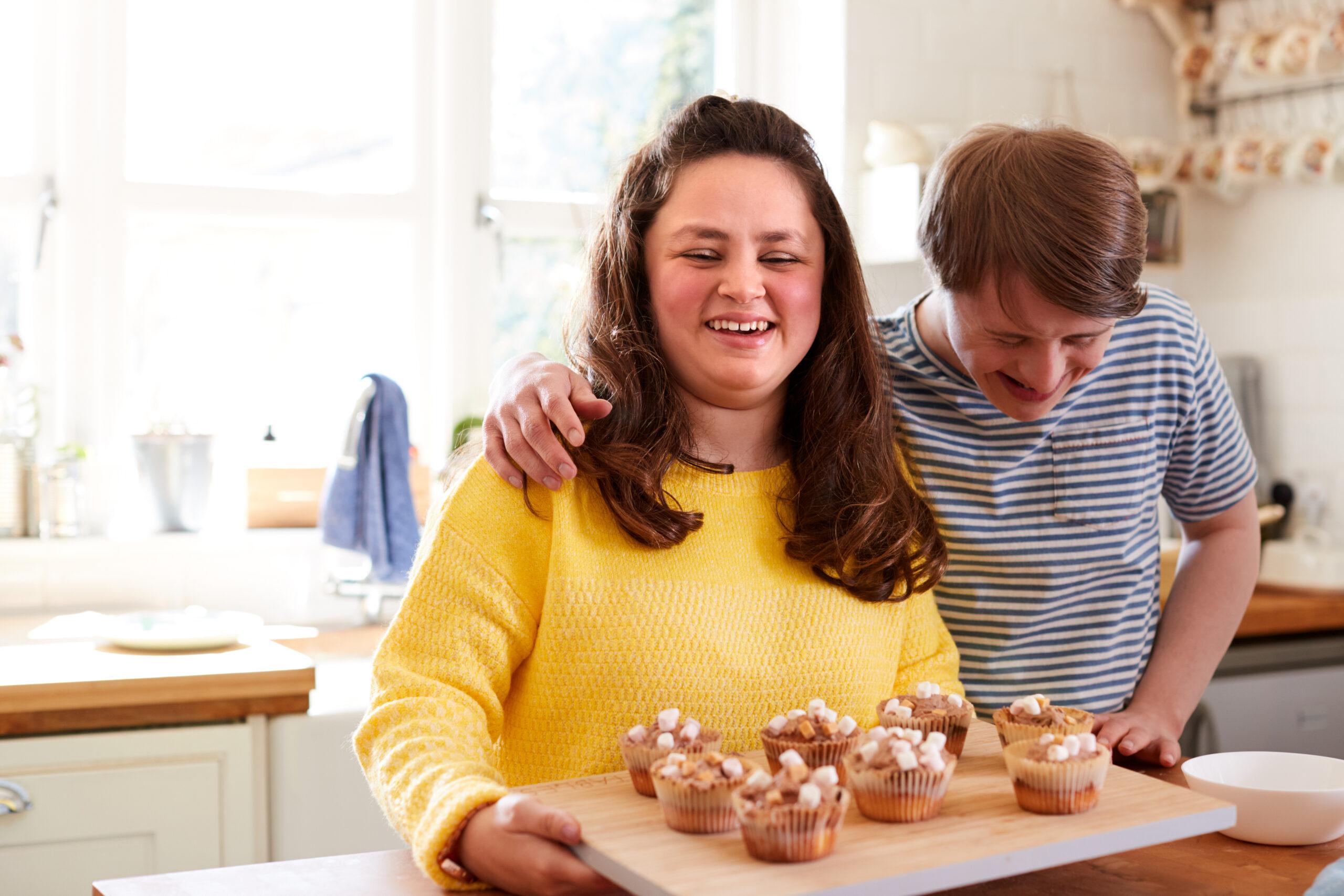couple-baking-muffins-in-their-kitchen