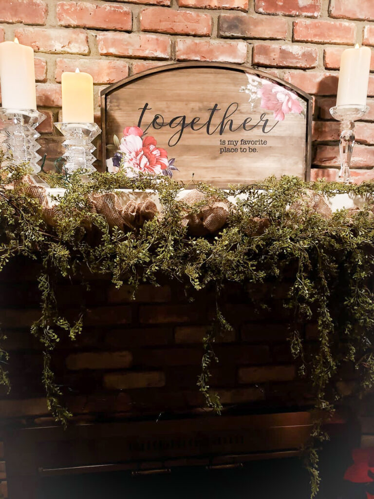 This rustic wood sign was created using antiquing wax, Essential Stencil stencil and stenciling brushes, black paint, and Re-Design with Prima transfer. The antiquing wax is what gives this rustic sign it's warm wood tones.