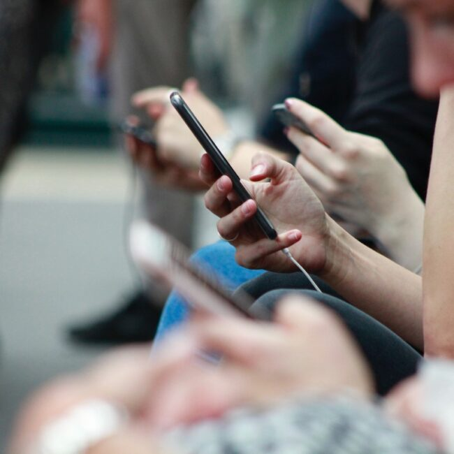 young people all using cell phones