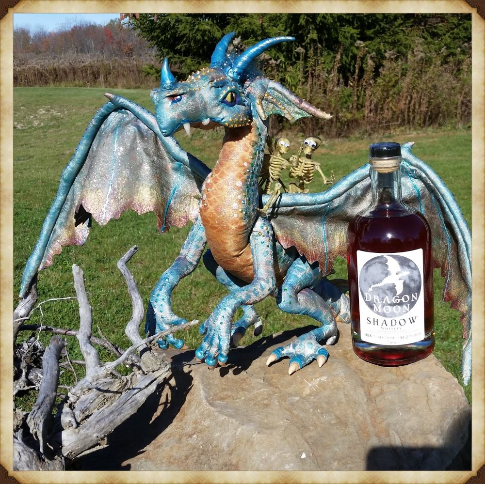 Betty the dragon and a bottle of Dragon Moon Shadow corn whiskey