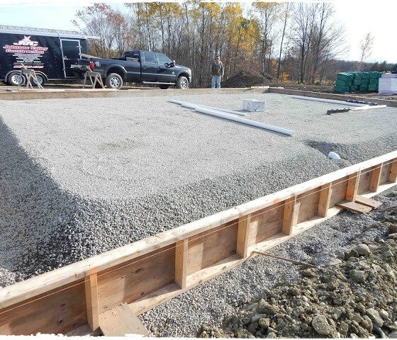 cravel in concrete form for distillery pad