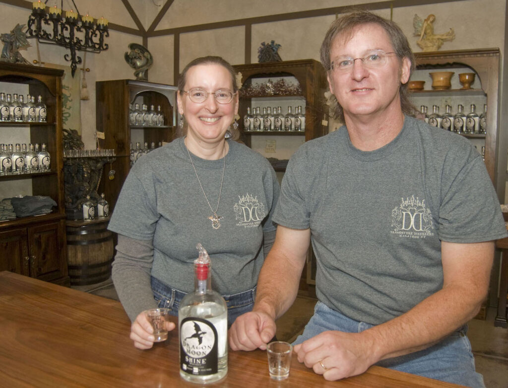 Vincent and Donna Pedini at the tasting room bar of Dragonfyre Distillery