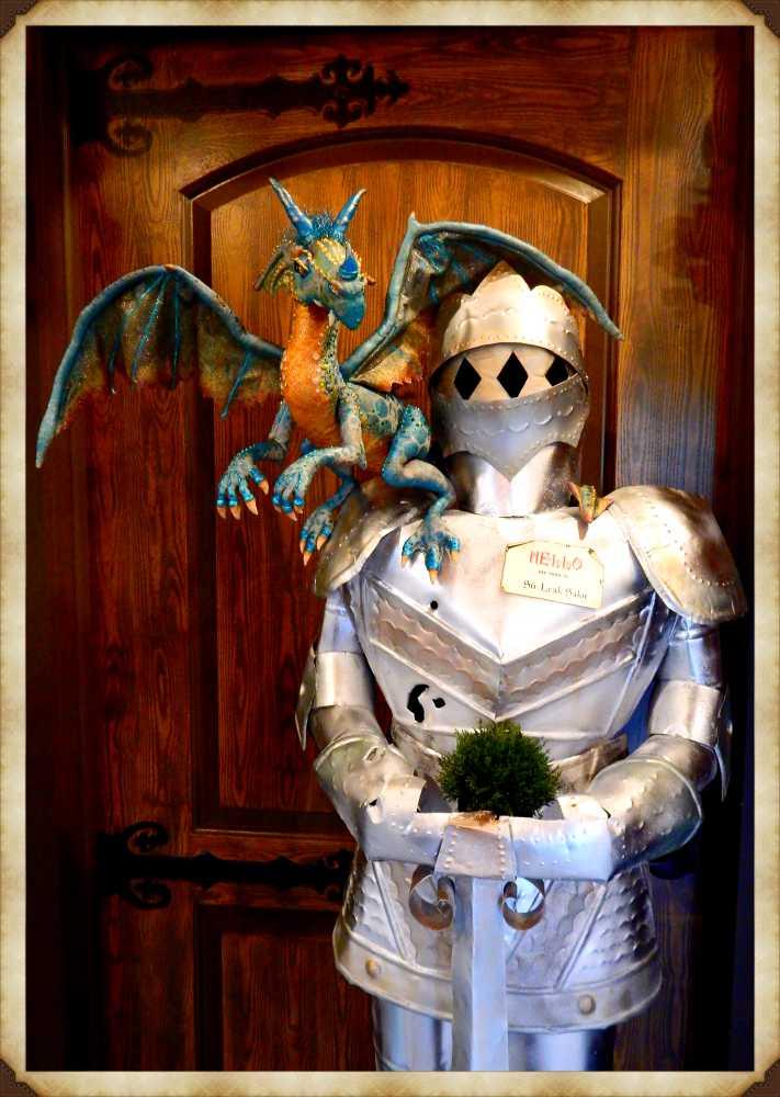 Betty the dragon and Sr Lea Ksalot holding a shrubery