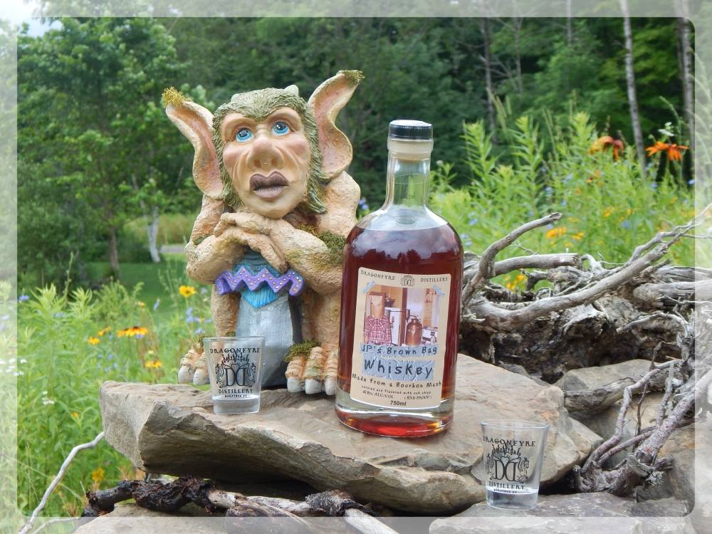 Castillostench the whiskey troll and a bottle of JP's Brown bag whiskey