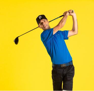 Mike swinging a golf club