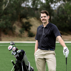 Scott Harris standing with his golf bag and clubs