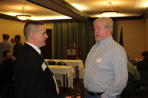 Reeves chats with a convention participant